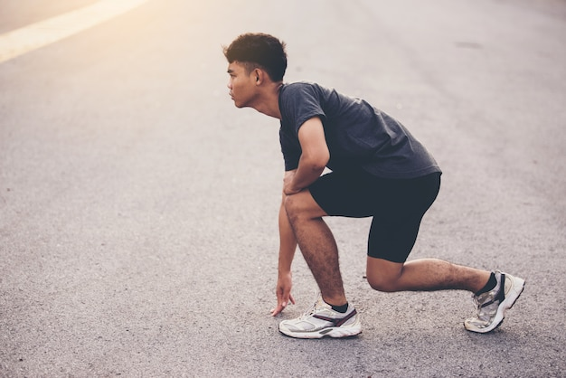 Sport concept, close up the man with runner on the street Free Photo