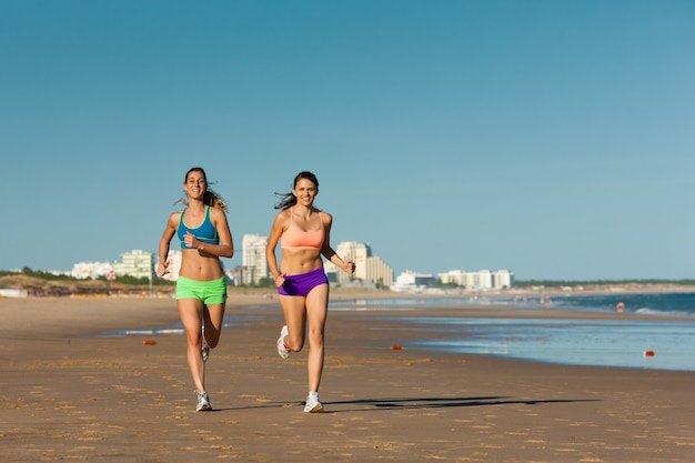 Sport and fitness,people jogging on beach Premium Photo
