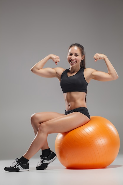 Sport girl doing exercises on a fitball Free Photo