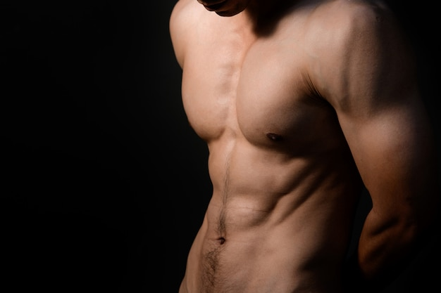 Sport guy, male model with muscle Premium Photo