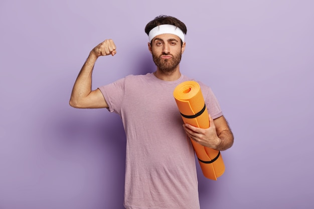 Sport is my life. unshaven man has workout in gym Free Photo