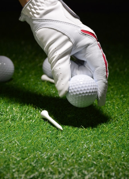 Sport objects related to golf such as gloves, balls etc. Premium Photo