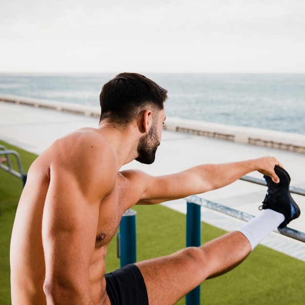 Sportive man warming up before running Free Photo