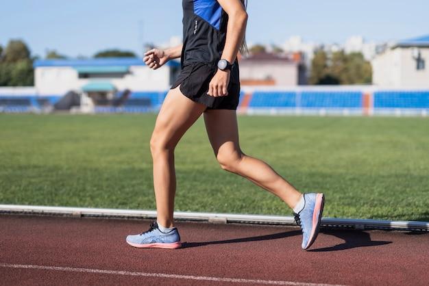 Sportive running at marathon on stadium Free Photo