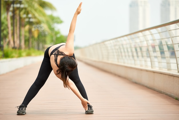 Sportive woman training on seafront Free Photo