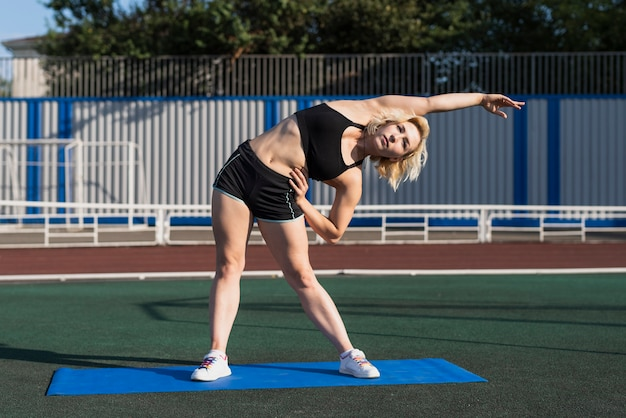 Sportive woman warming before training Free Photo