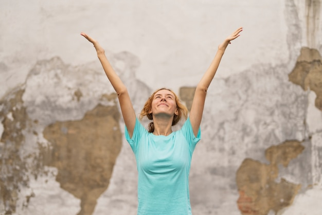 Sportive woman with hands raised Free Photo