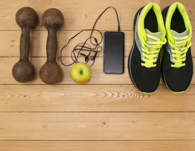 Sports accessories for fitness on the wooden floor. Premium Photo