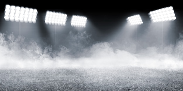 Sports arena with concrete floor with smokes and spotlights background Premium Photo