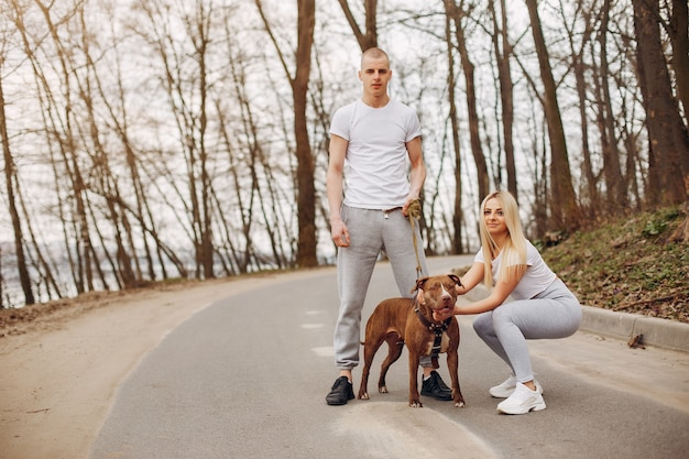 Sports couple in a summer park Free Photo