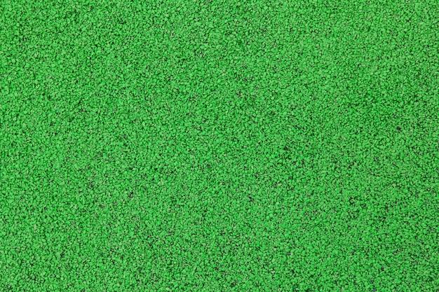Спортивная площадка или площадка фон. покрытие из искусственного каучука для детских и спортивных площадок зеленого цвета Premium Фотографии