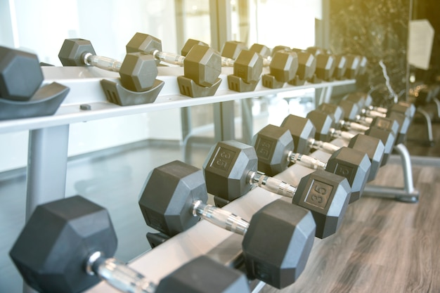 Sports dumbbells in modern sports club for a exercise in the fitness center in gym Premium Photo