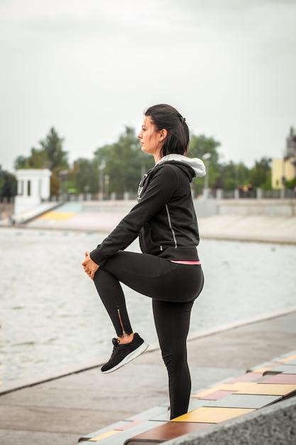 Sports girl does yoga Free Photo