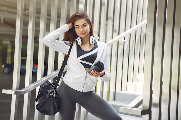 Sports girl in a sports clothes in a city Free Photo