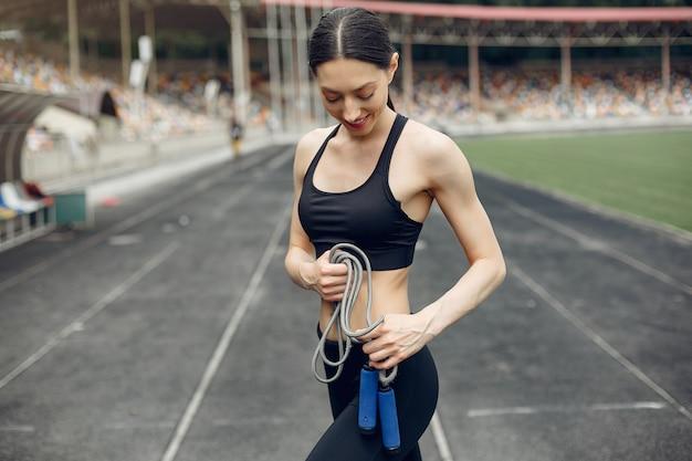 Sports girl training at the stadium Free Photo