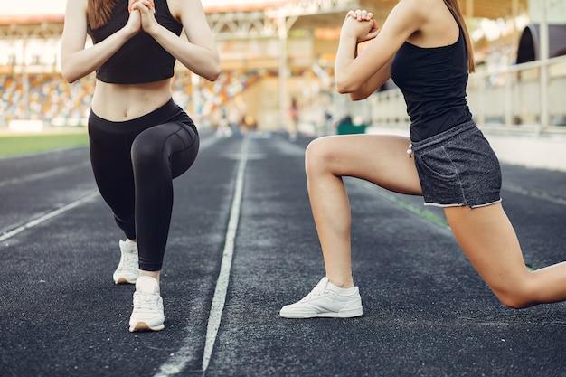 Sports girls training at the stadium Free Photo