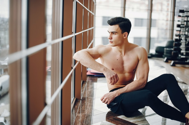 Sports man in a morning gym Free Photo