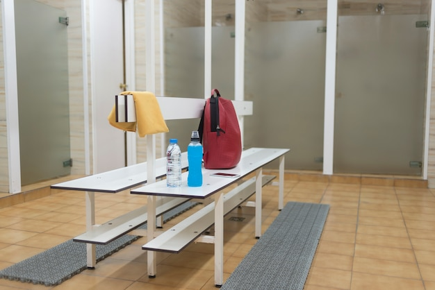 Awesome Sports Supplies On A Wooden Bench In A Gym Locker Room Photo Beatyapartments Chair Design Images Beatyapartmentscom