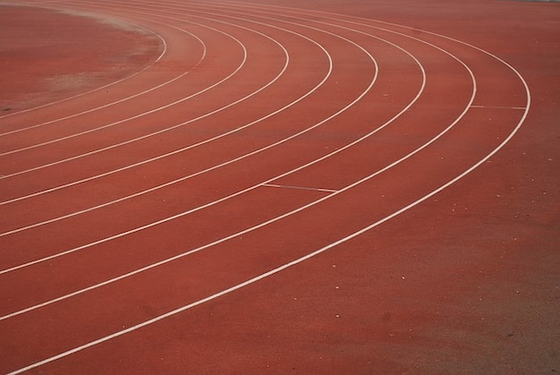 Sports track lanes runners competition field Photo | Free Download