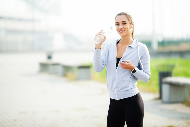 Sports woman after sports exercises in the urban environment Premium Photo
