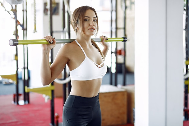 Sports woman training in a morning gym Free Photo