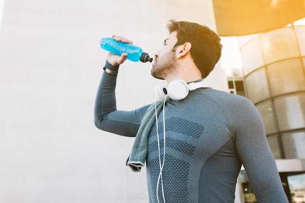 Sportsman drinking water Free Photo