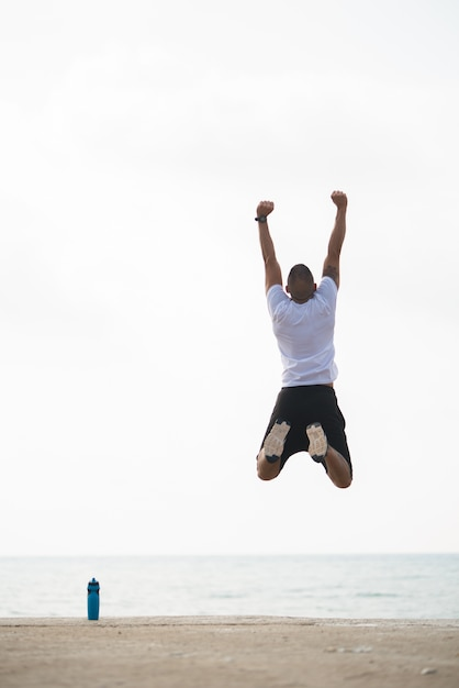 Sportsman jumping for joy outdoors Free Photo