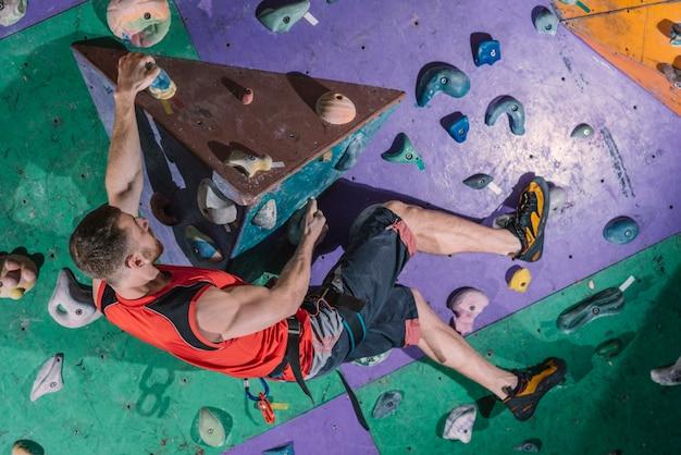 Sportsman on climbing wall 23 2147795580