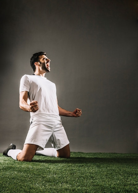Sportsman shouting while rejoicing over victory Free Photo