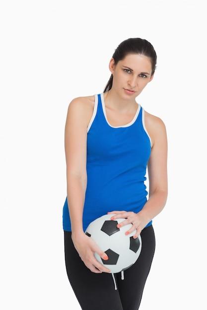 Sportswoman holding a soccer ball Premium Photo