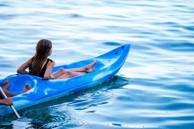 Sporty attractive family kayaking on sea together Premium Photo