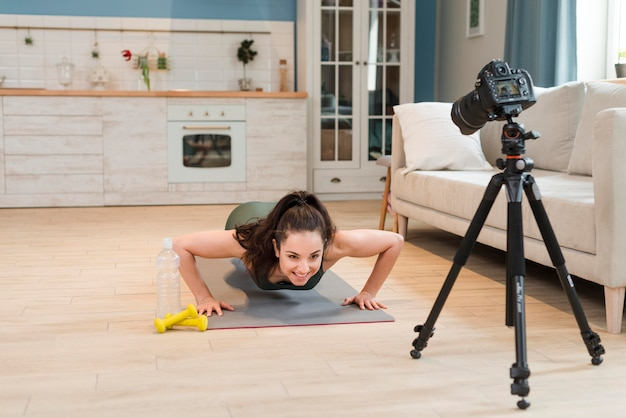 Sporty blogger doing pushups in front of camera Free Photo