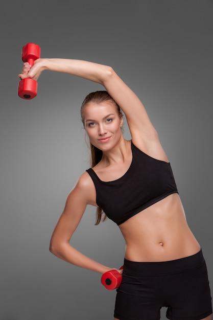 Sporty woman doing aerobic exercise Free Photo