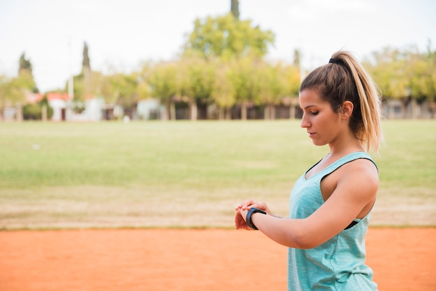 Sporty woman looking at fitnesstracker Free Photo