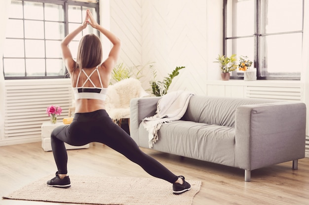 Sporty woman working out at home Free Photo