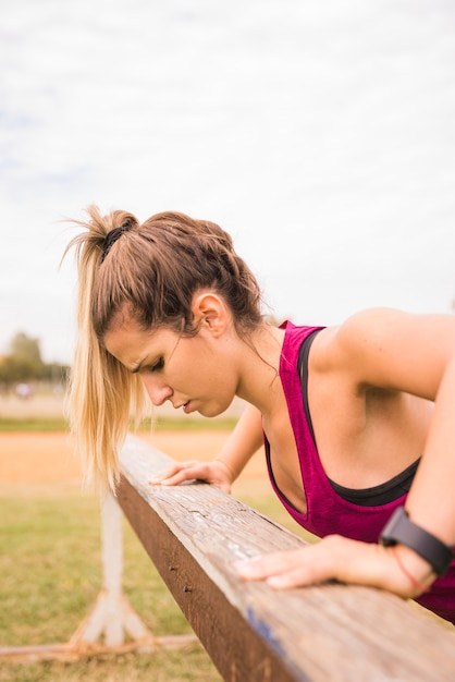 Sporty woman working out on stadium track Free Photo