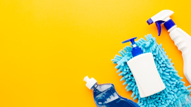 Spray bottle and sanitary products Free Photo