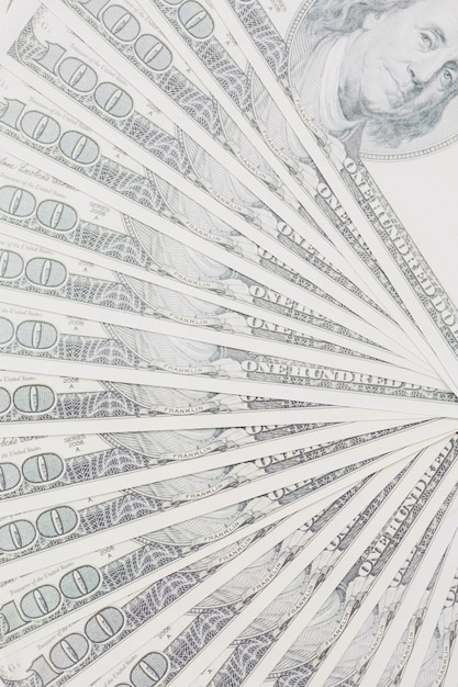 Spread us one hundred dollars bills background Free Photo