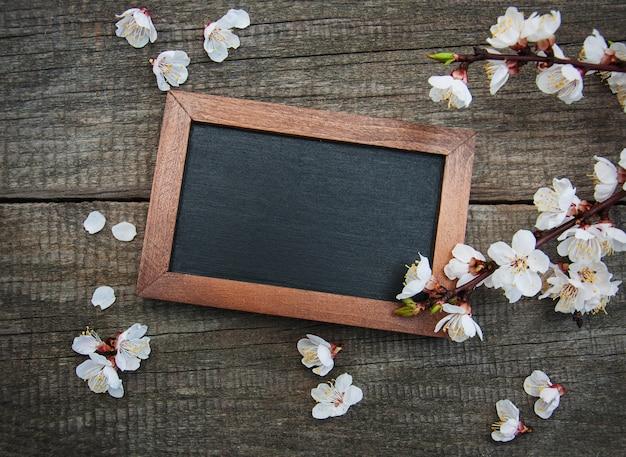 Spring apricot  blossom and blackboard Premium Photo