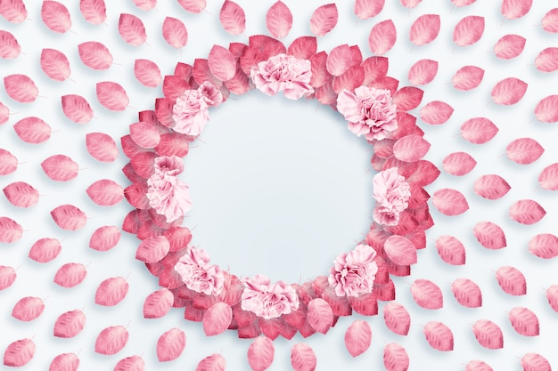 Spring background, round frame, a wreath of pink, red carnations on a light background Premium Photo