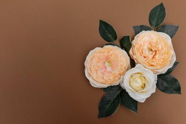 Spring beautiful flowers on brown, feminine beauty background Premium Photo