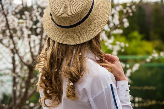 Spring beautiful life style blonde girl among flowers Premium Photo