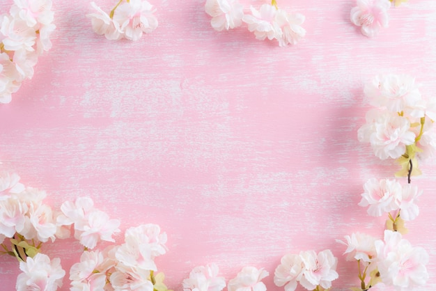 Spring blooming branches on pink wooden background Premium Photo