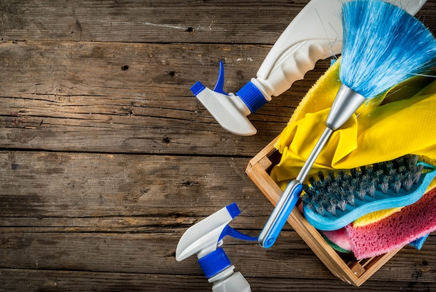 Spring cleaning concept with supplies, house cleaning products pile Premium Photo