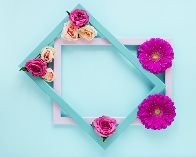 Spring floral frame concept with blue background Free Photo