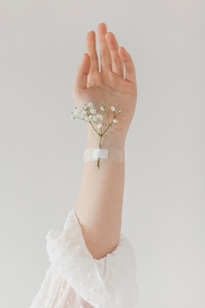 Spring flower stuck on arm Free Photo