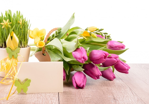Spring flowers and an empty greeting card Premium Photo