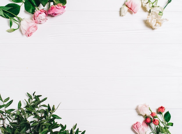 Spring flowers pink flowers on white wooden background flat lay spring flowers pink flowers on white wooden background flat lay top view mightylinksfo