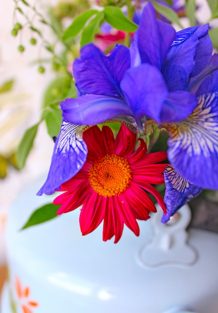 Spring flowers in a teapot Premium Photo