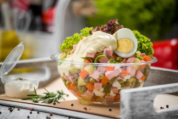 Spring salad with spinach,egg,ham Premium Photo